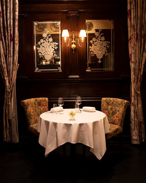 Romantic setup with a table for two at the Bristol Grill